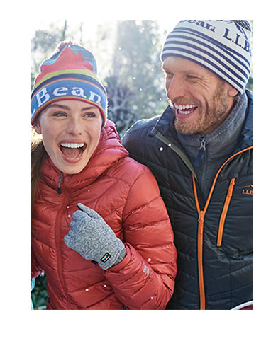 Man and woman outside laughing, wearing L.L.Bean outerwear
