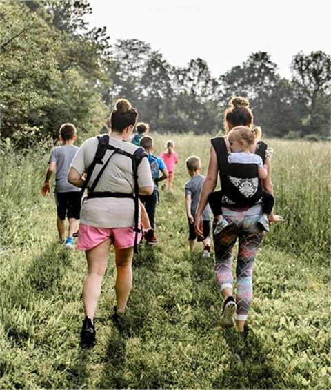 People with packs on taking off on a Hike it Baby planned hike