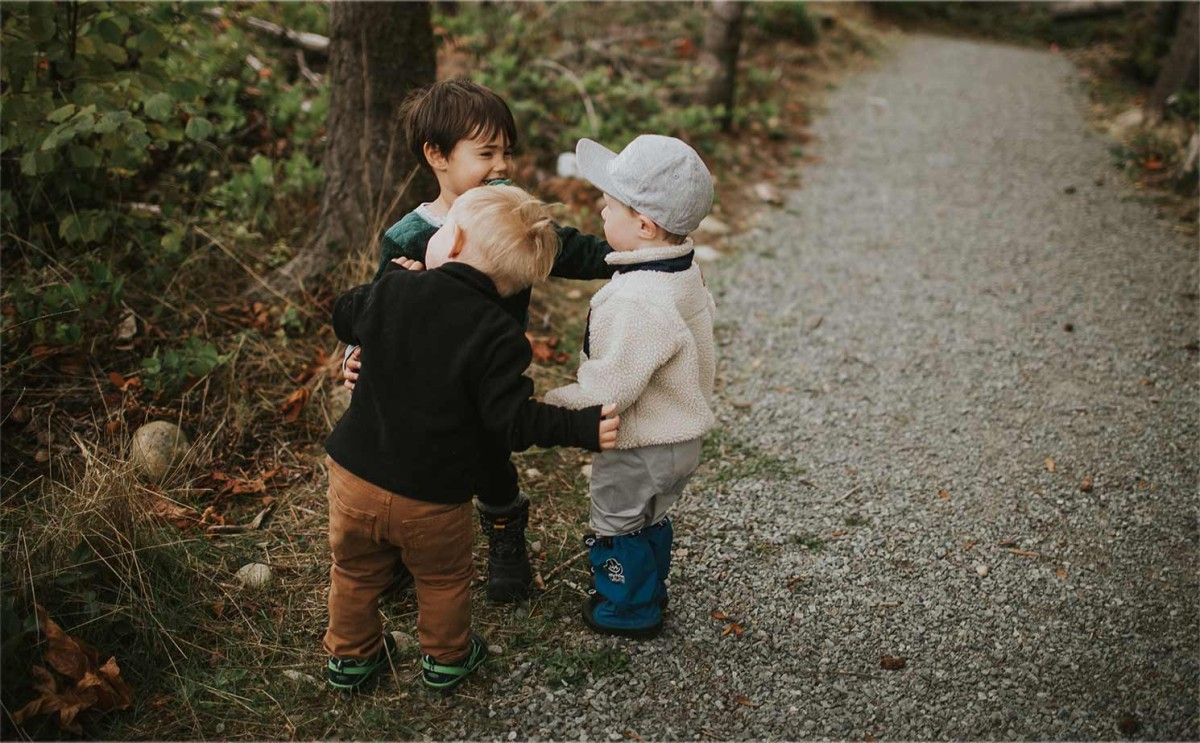Little kids grouped together having fun on way to hike