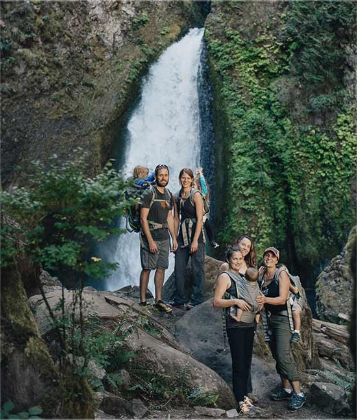 Group of people by beautiful waterfall on Hike it Baby hike.