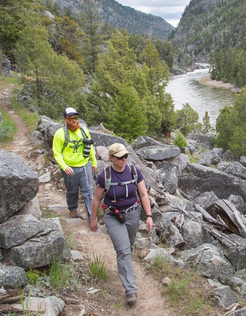 Two friends hiking a trail in Yellowstone National Park.