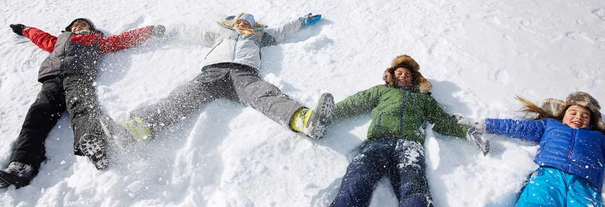Kids making snow angels.