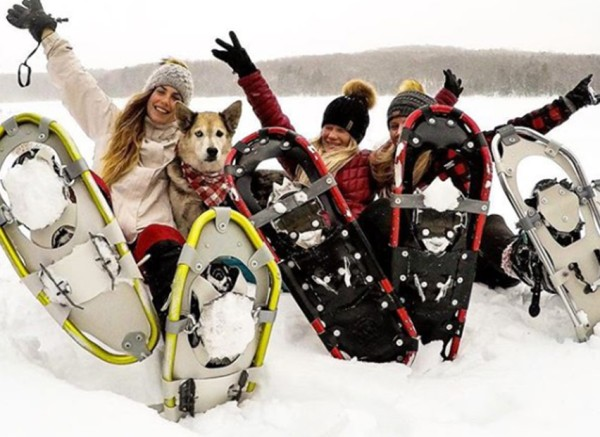 Friends enjoying a snowshoe adventure together.