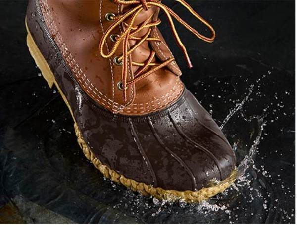 L.L.Bean Boot splashing through water.
