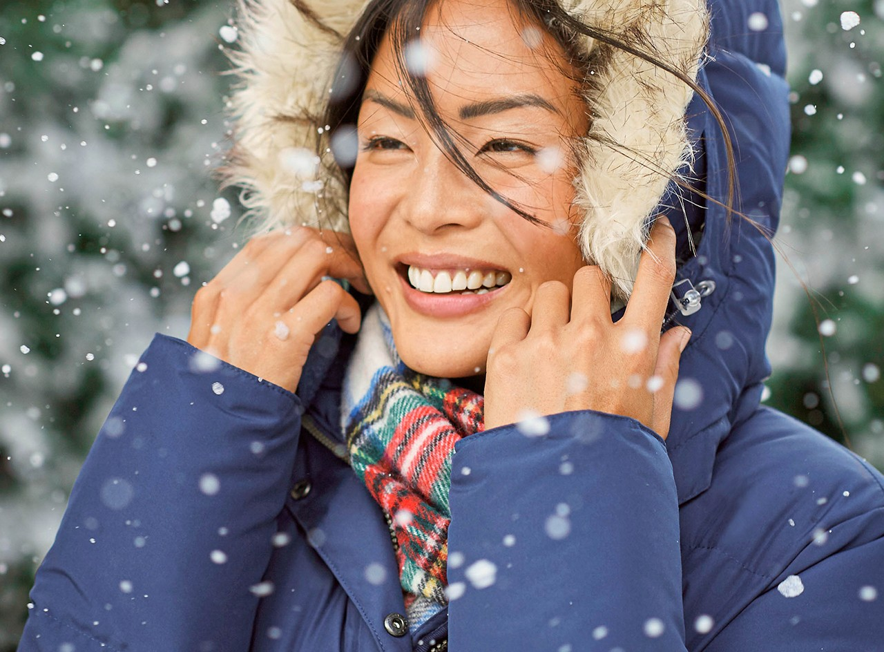 smiling woman in an insulated L.L. Bean winter jacket.
