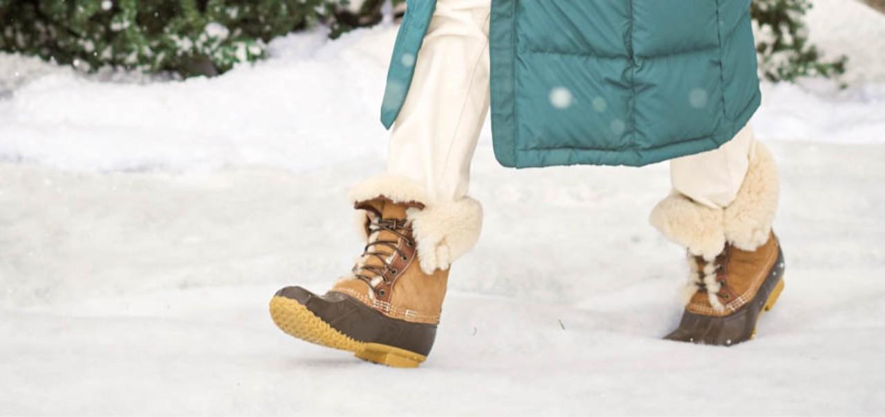 Woman walking thru the snow