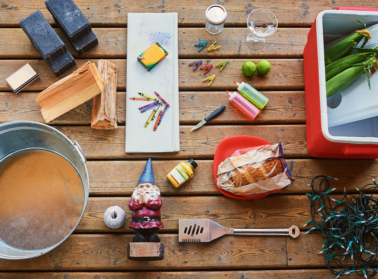 Overhead of a picnic table with everything you need for backyard fun.