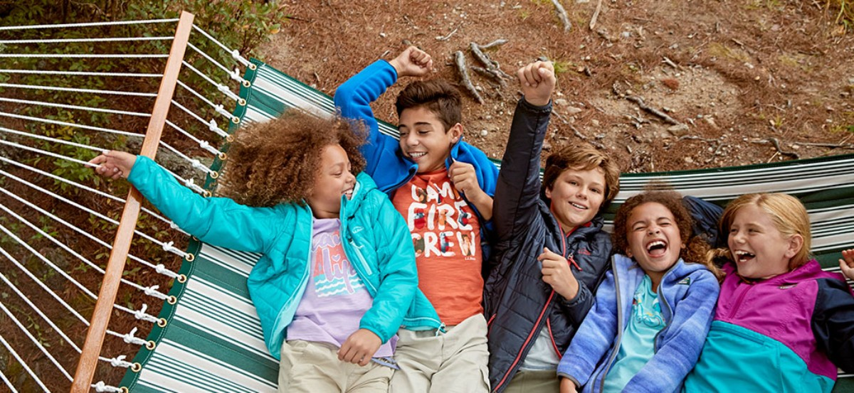 5 laughing kids on a hammock.