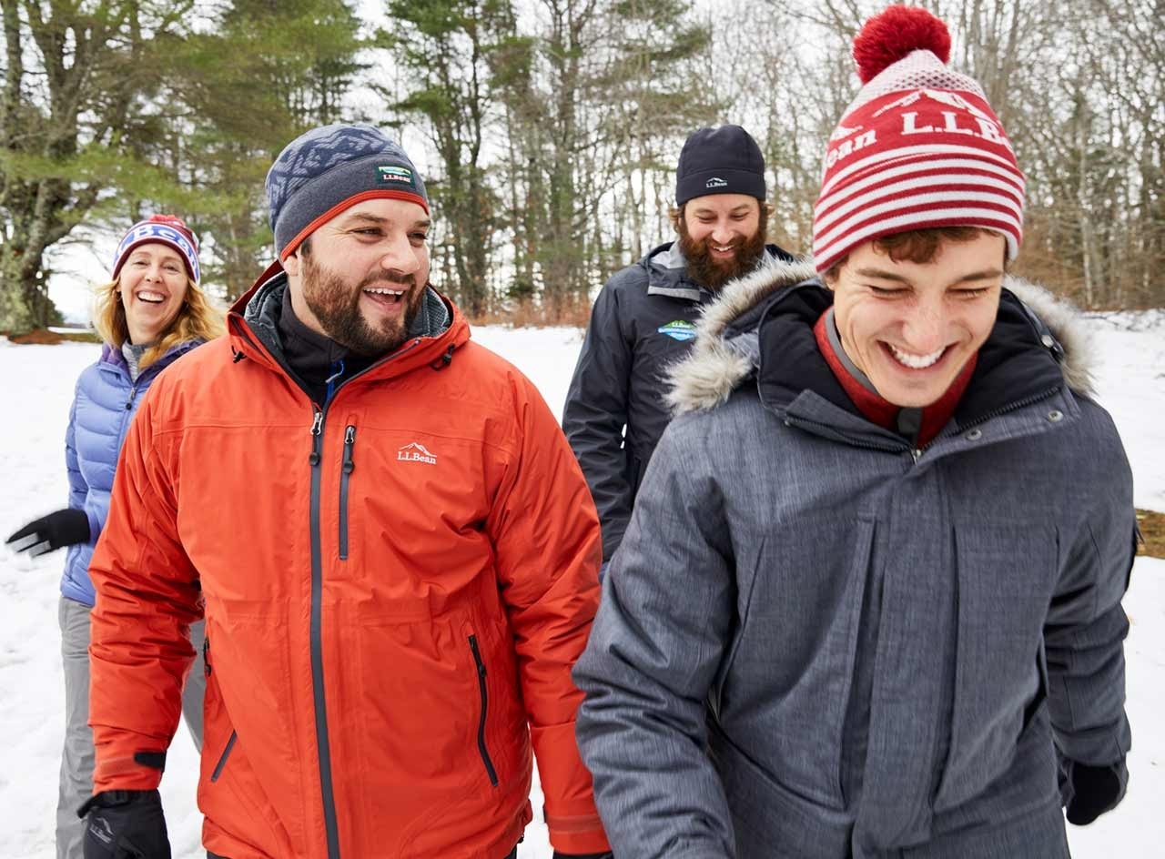 Group of 4 people dressed in L. L. Bean outerwear and winter hats.