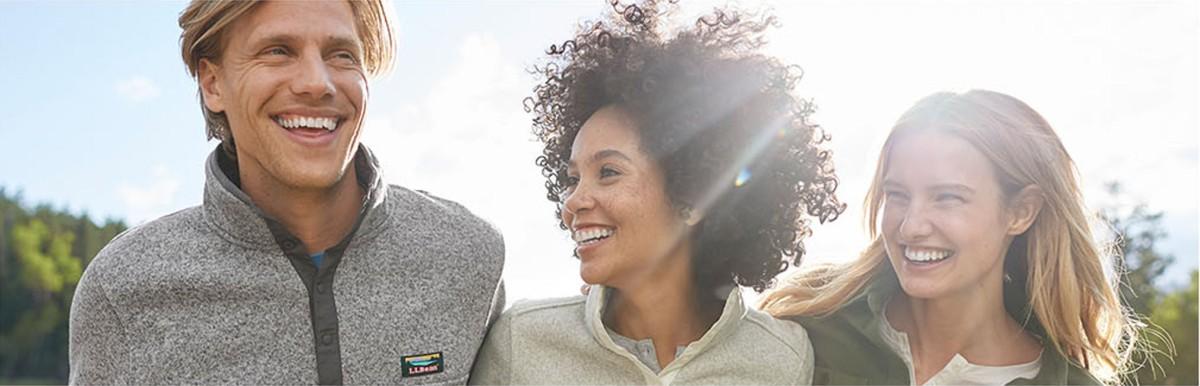 One man and two women enjoying the sunshine wearing L.L.Bean Sweater Fleece.