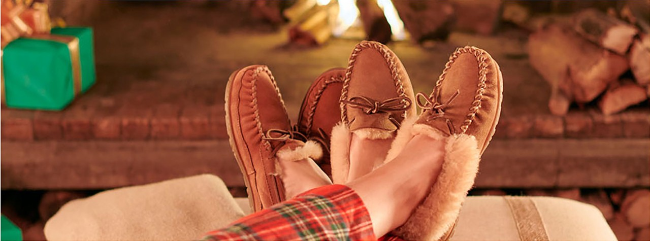 Slippers in front of a fire