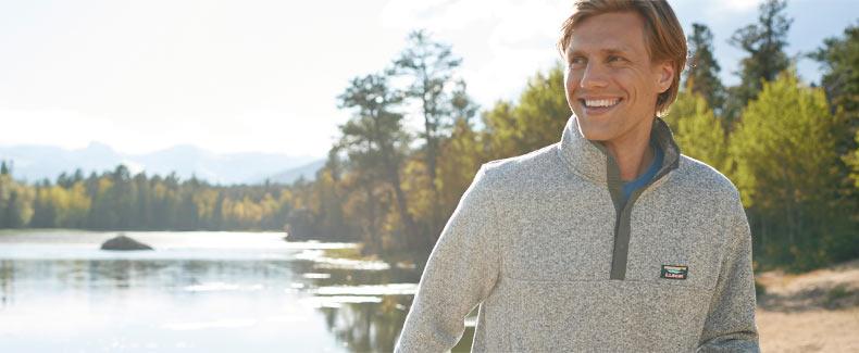 A man enjoying a day at the park in a warm L.L.Bean sweater fleece.