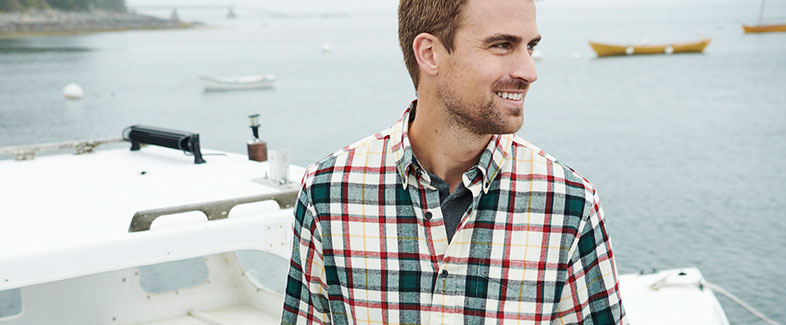A man enjoying a boat ride in an L.L.Bean flannel shirt.