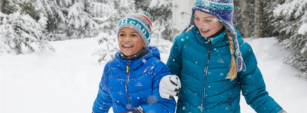 A boy and a girl enjoying winter weather in cold-weather LLBean outerwear.