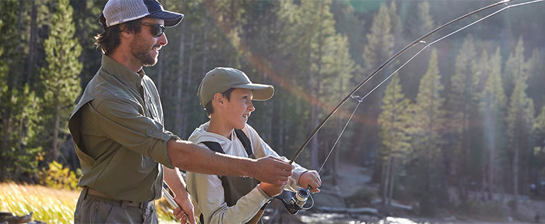 Father and son enjoying a day fishing.