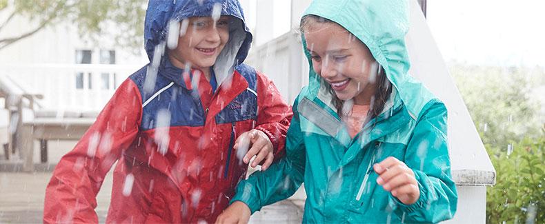 Kids playing in the rain.