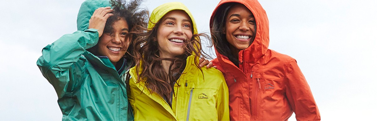Three women staying dry and protected from the wind in L.L.Bean rainwear.