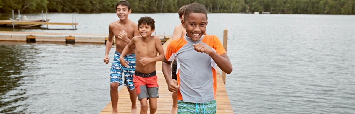 Group of Boys running on dock