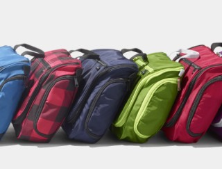 Splay of 5 colorful toiletry bags
