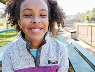 Close-up of happy girl outside in L.L.Bean apparel