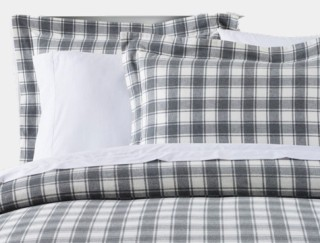 Close-up of cozy bed made with flannel sheets