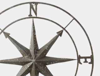Close-up of metal compass rose