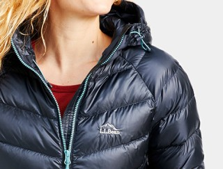 Close-up of woman wearing hooded down Jacket