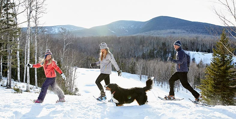 A family enjoying a snowshoe adventure.