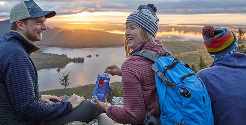 People outdoors overlooking view with ridge runner packs on.