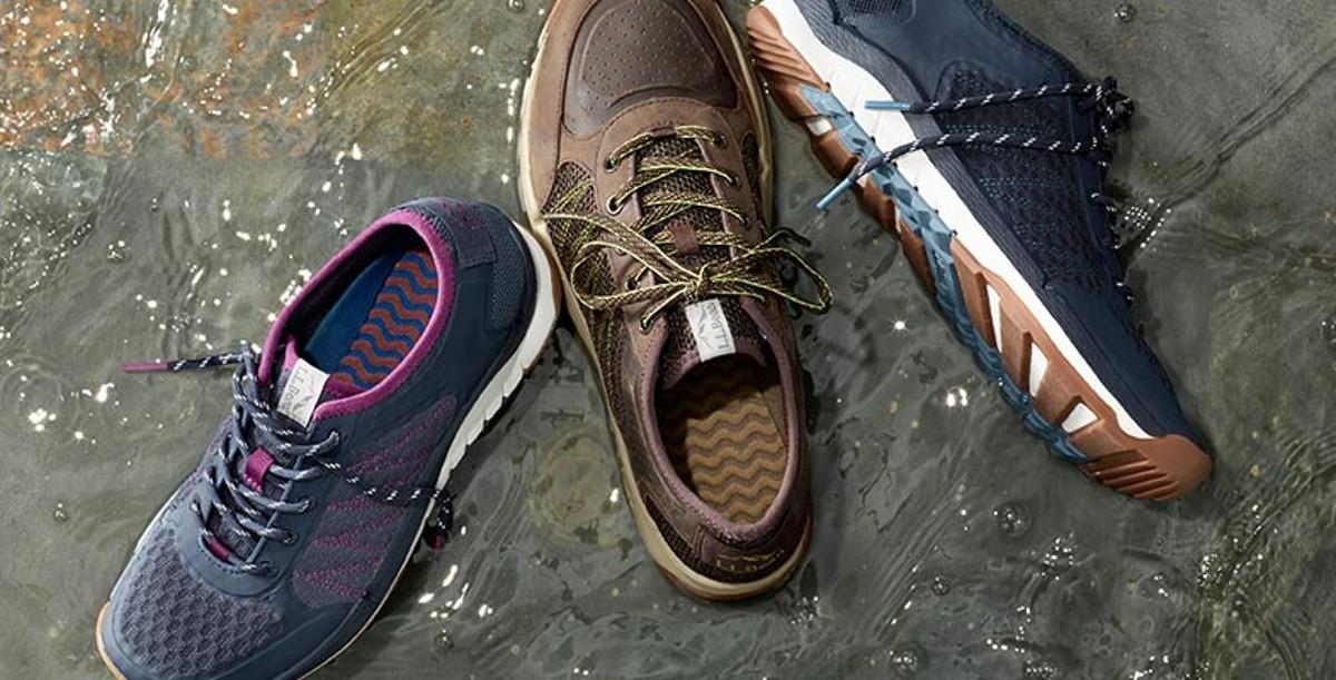 Three shoes on rocks.