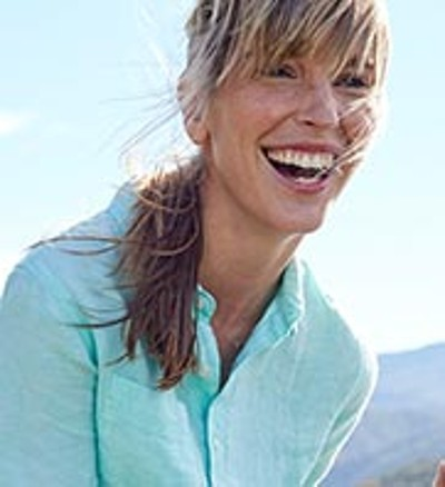 Close-up of smiling woman outside