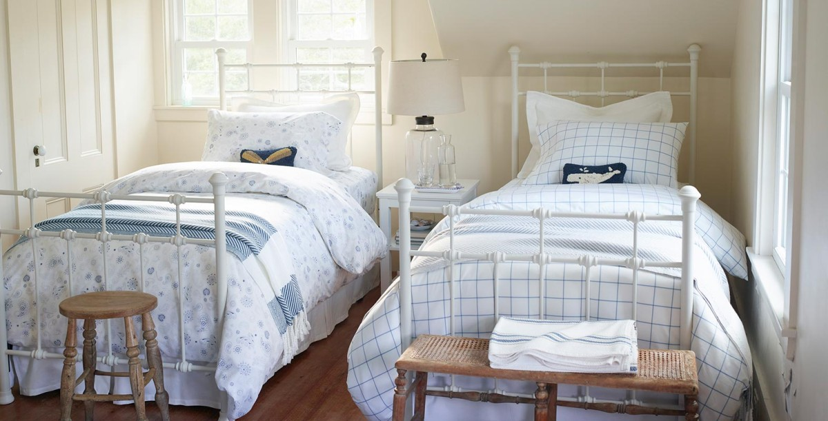 Two twin metal frame beds with pima cotton percale bedding