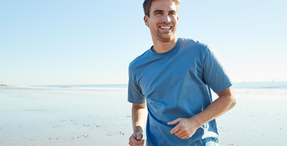Man jogging, wearing Carefree Unshrinkable short sleeved tee.