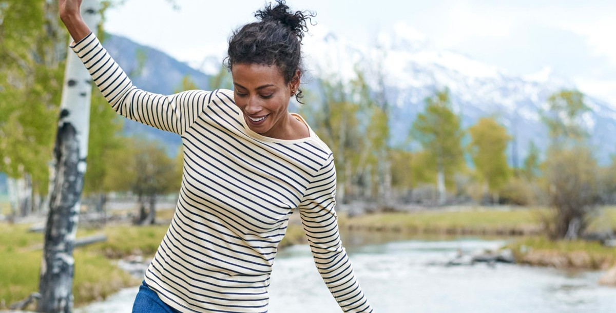 Active woman near a river.