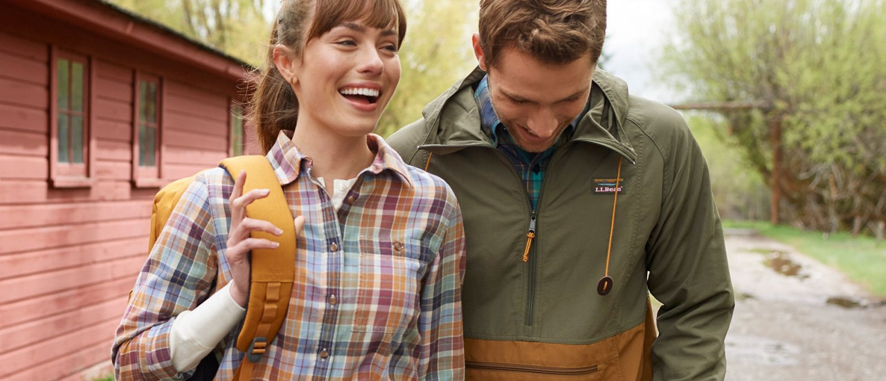 Close-up of woman and man outside wearing L.L.Bean apparel.