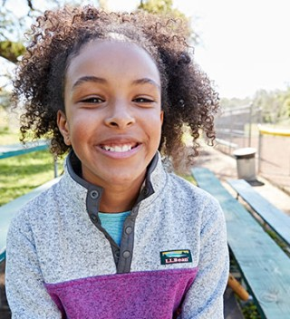 Close-up of smiling girl wearing L.L.Bean apparel.