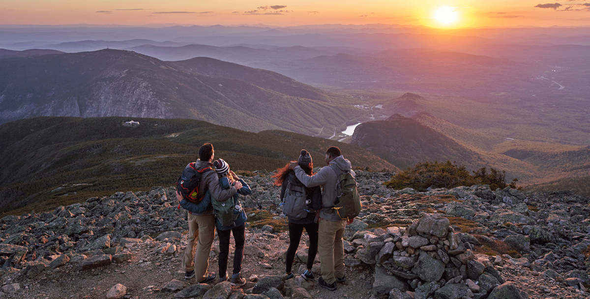 Four hikers viewing sunset
