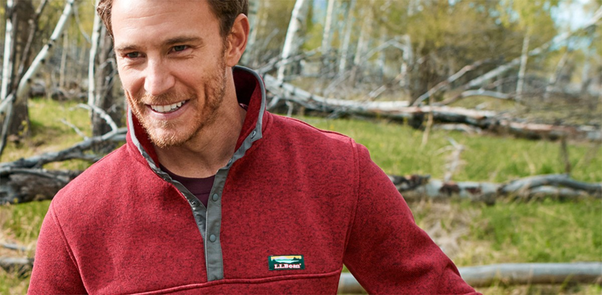 Man wearing Sweater Fleece pullover while enjoying the outdoors.