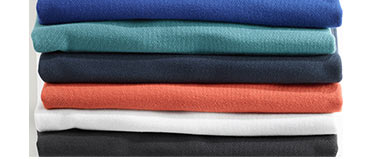 A stack of men's polo shirts.