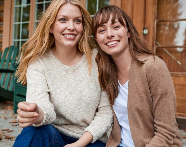 Close up of 2 women outside wearing LL.Bean sweaters