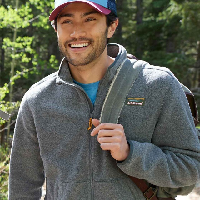 Man wearing fleece jacket and carrying pack