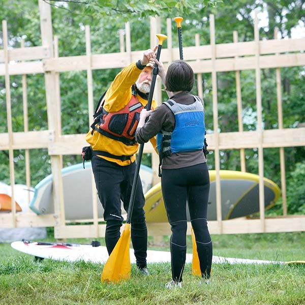 L.L.Bean Guide showing customer how to hold Stand up Paddle Board Oar