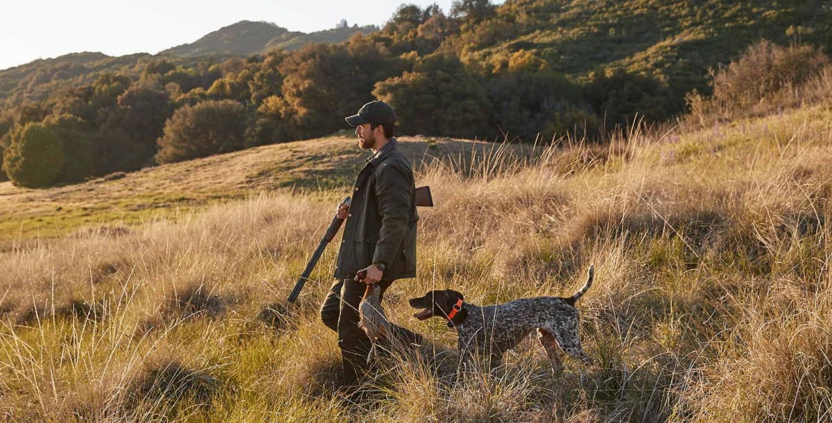 Man and Dog out hunting.