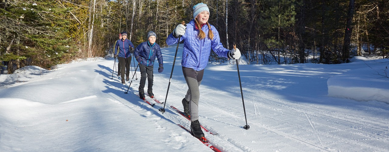 A family out cross-country skiing.