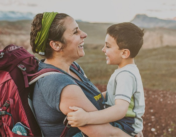 Photo of a mother and son hiking
