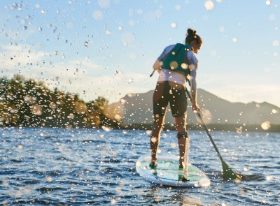 Woman paddling on a stand up paddleboard.