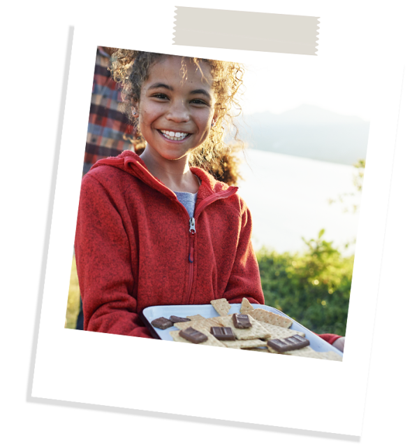 Young girl in L.L.Bean fleece with a tray of s'mores.