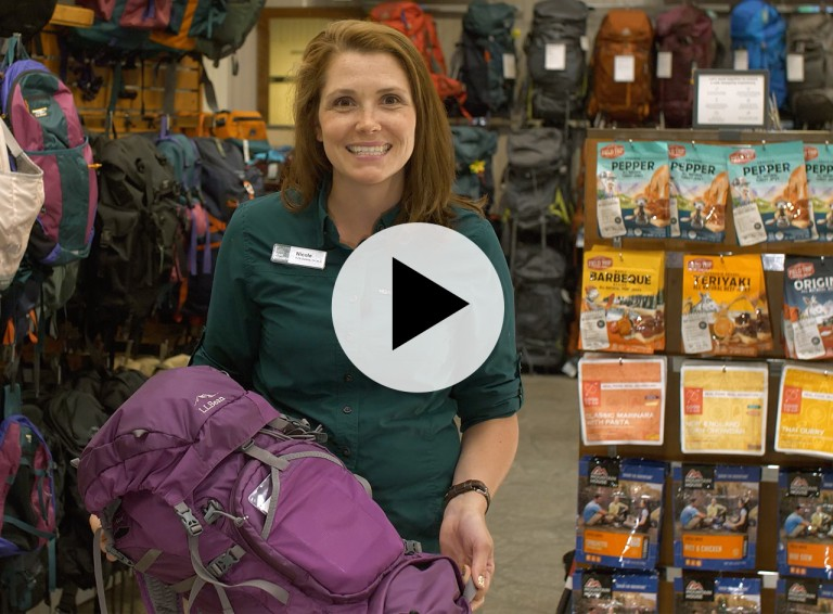An L. L. Bean Customer Service Rep holding a hiking pack, a play video symbol in center.