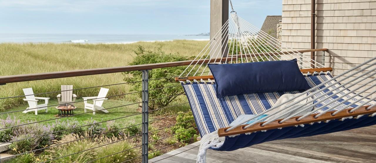 Hammock on porch overlooking beach