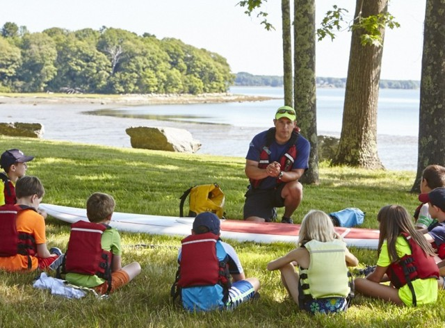 Outdoor Discovery instructor with children at camp.